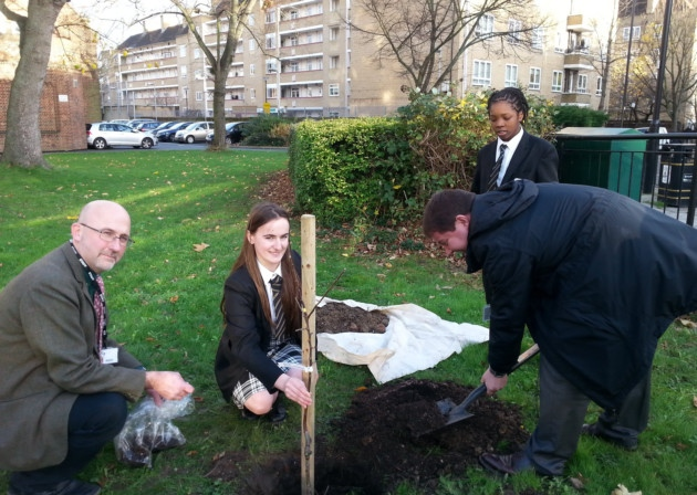 Teacher Justin Willson, with Erjola Noka, Cllr Andy Hull and year 8 student from the gardening club looking on.