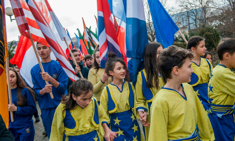 Young Kosovo Albanians holding the flags of the countries that recognised Kosovo's Independence, march in Pristina on the eve of the celebrations of the 10th anniversary of Kosovo independence. Photograph: Armend Nimani/AFP/Getty Images