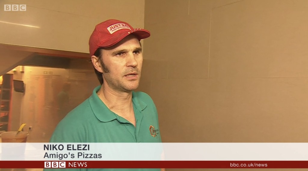 Niko Elezi the owner of Amigos Pizza, Salisbury, talking on BBC News