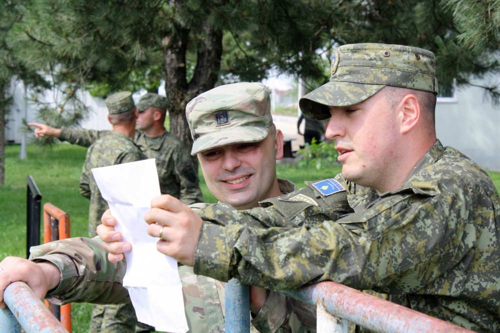 Capt. Gent Kepuska, left, and Centre for University Studies Commander Capt. Vegim Krelani review a training plan for Kosovo Security Force cadets in Pristina, Kosovo, on May 22. Kepuska is part of a U.S. Army team that is advising the Centre for University Studies on the training of Kosovo Security Force cadets. Photo By Capt. Jason Sweeney