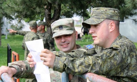 An Albanian-American and a Serbian-American U.S. Army officers, work together in Kosovo