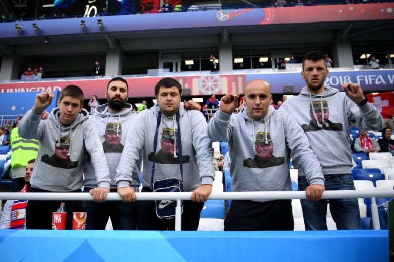 Serbia supporters displayed images of war criminal Ratko Mladic pictures and hurled abuse at Swiss Albanians before and during the match
