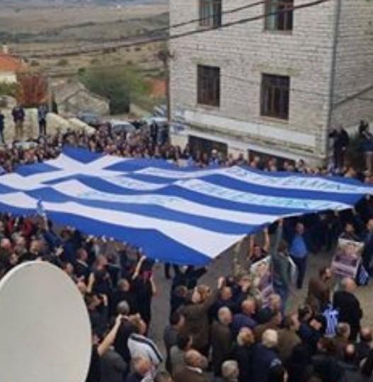 Greek extremists holding a big Greek flag in Albania, chanting racist anti-Albanian slogans