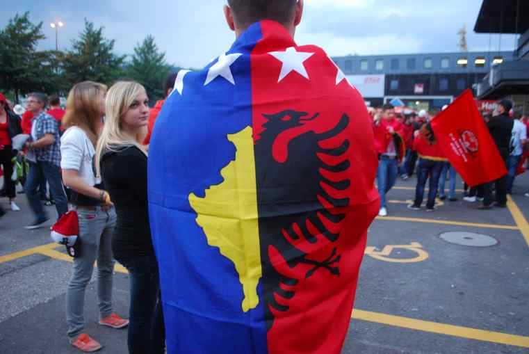 An Albanian football fan with a combined Kosovo and Albania flags