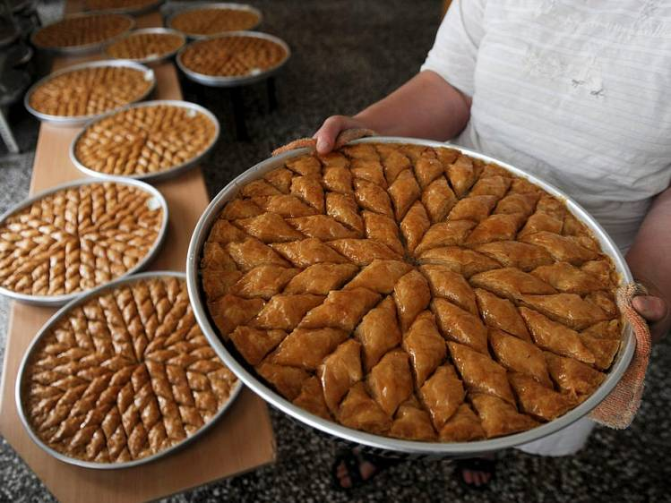 An employee arranges baklava pastries at a bakery in Pristina, Kosovo. ARMEND NIMANI/AFP/Getty Images