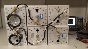 """Six cavity (8""""diameter) duplexer system on the bench ready to go to the new site where single antenna working is required."""