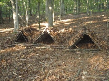 three survival shelters in a row