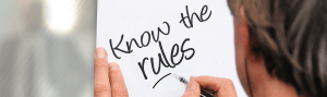 writing the phrase Know The Rules