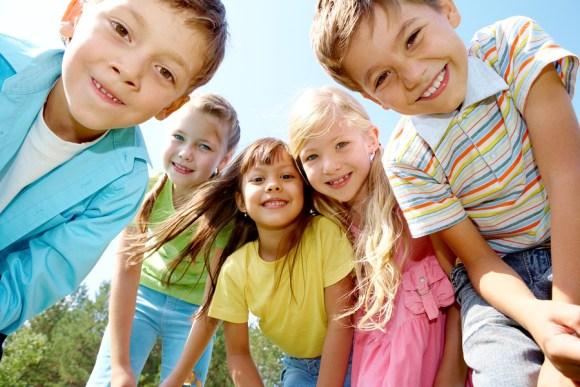 Portrait of happy kids outdoor looking at camera
