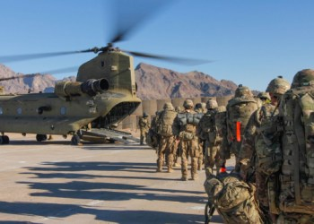 Soldiers attached to the 101st Resolute Support Sustainment Brigade from the 1034th Combat Sustainment Support Battalion, Iowa National Guard and 10th Mountain, 2-14 Infantry Battalion, Ghost Forward Support Company load onto a Chinook helicopter to head out and execute missions across the Combined Joint Operations Area- Afghanistan