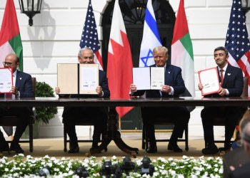 (L-R)Bahrain Foreign Minister Abdullatif al-Zayani, Israeli Prime Minister Benjamin Netanyahu, US President Donald Trump, and UAE Foreign Minister Abdullah bin Zayed Al-Nahyan hold up documents as they participated in the signing of the Abraham Accords where the countries of Bahrain and the United Arab Emirates recognize Israel, at the White House in Washington, DC, September 15, 2020. - Israeli Prime Minister Benjamin Netanyahu and the foreign ministers of Bahrain and the United Arab Emirates arrived September 15, 2020 at the White House to sign historic accords normalizing ties between the Jewish and Arab states. (Photo by SAUL LOEB / AFP)