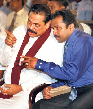 Image result for karuna amman with mahinda