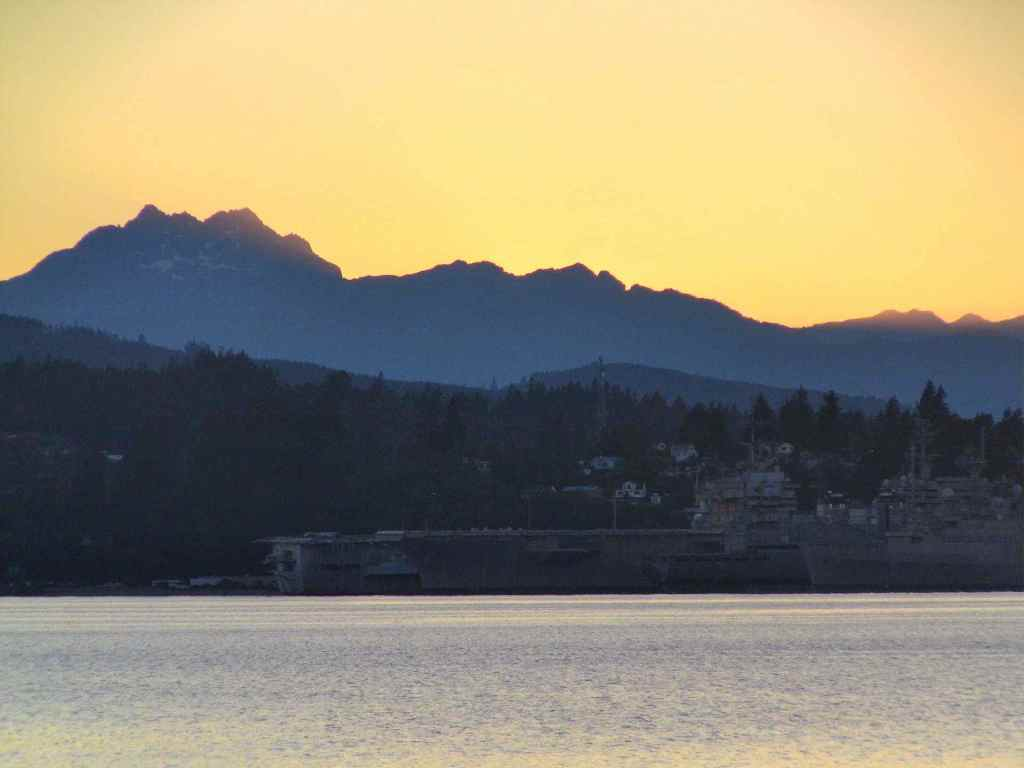 The Olympic Mountains loom nearby.