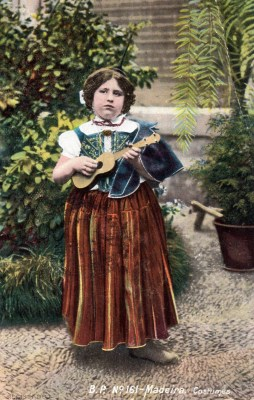 This vintage postcard image shows a young Madeiran girl with a machete.
