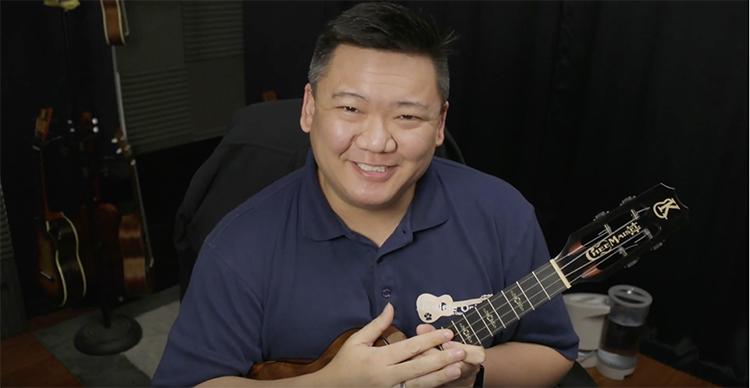 Craig Chee holding a ukulele