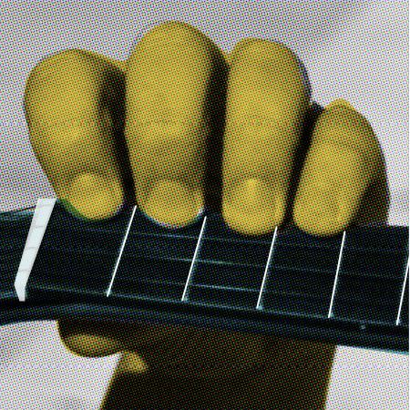 Hand holding a ukulele neck