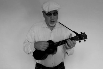 Eddie Scher playing jazz ukulele black and white photo