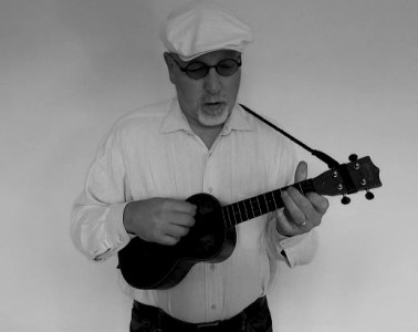Eddie Scher playing jazz ukulele black and white photo