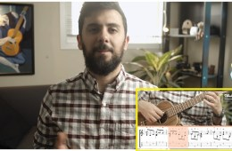 man smiling with ukulele lesson screenshot in corner