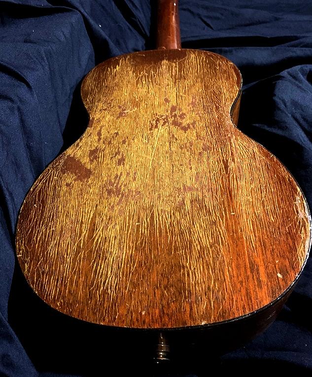 vintage martin ukulele restoration—back with scratches in the lamination
