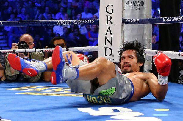 Manny Pacquiao is knocked down in the third round while taking on Juan Manuel Marquez