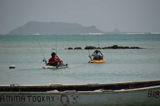Départ en kayak pour la barre de corail