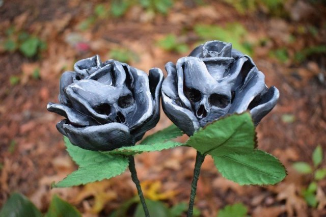 two roses with skulls