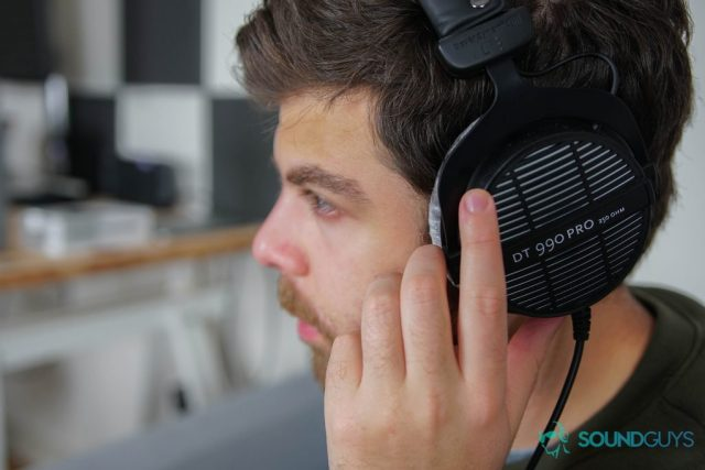 A photo of the Beyerdynamic DT990 PRO being worn by writer Adam Molina.