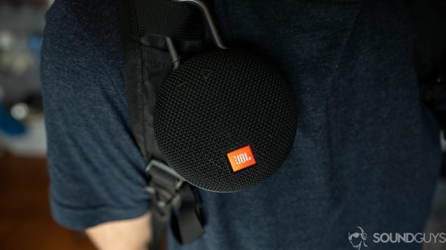 Pictured is the JBL Clip 3 attached to a backpack strap.