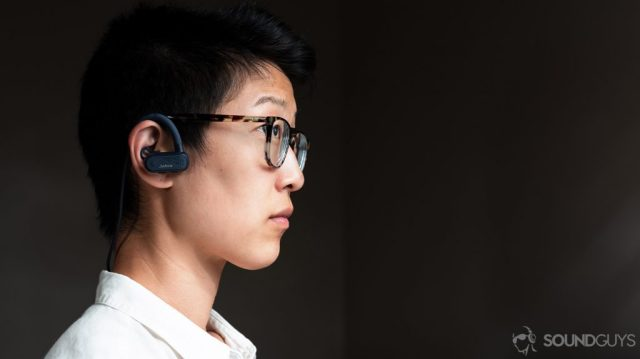 A photo of a woman wearing the Jabra Elite Active 45e earbuds.