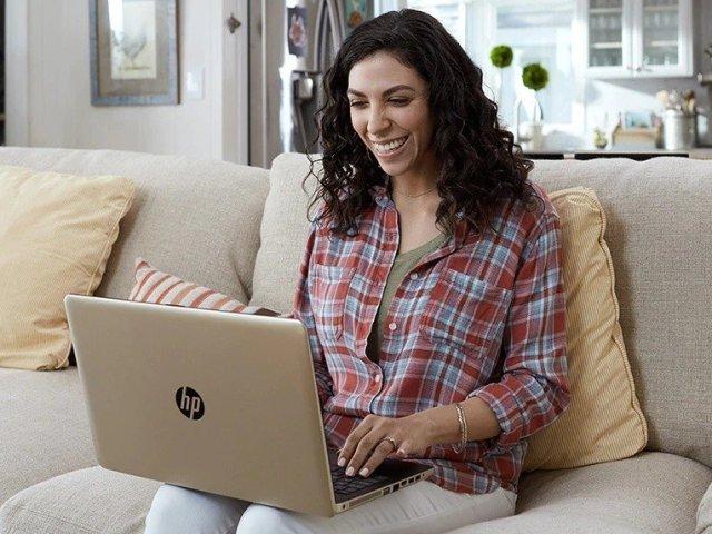 Woman using HP laptop