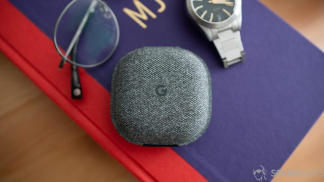 Shot of the Pixel Buds charging case on a book.