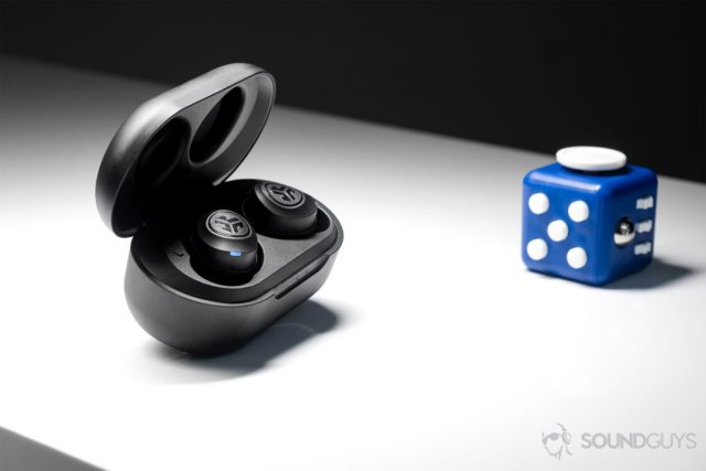 A picture of the JLab JBuds Air true wireless workout earbuds (black) in the charging case, which is angled slightly away from the camera.