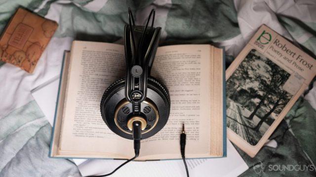 An aerial photo of the AKG K240 Studio semi-open headphones on an open book.