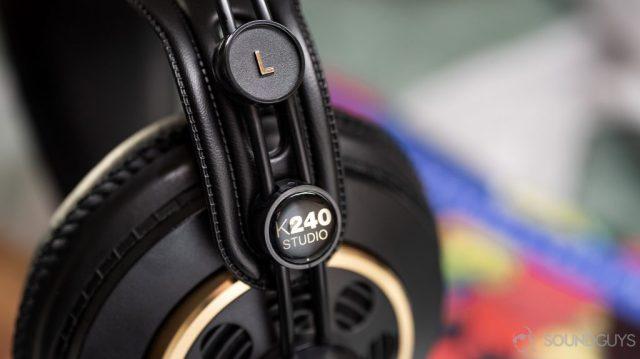 A photo of the AKG K240 Studio semi-open headphones with the slider mechanism in focus.