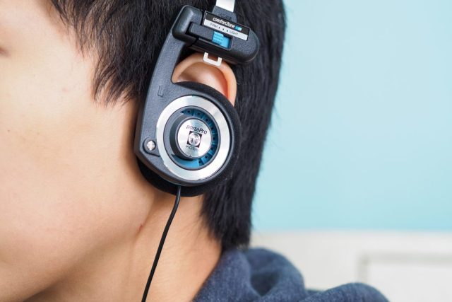A photo of the Koss Porta Pro semi-open headphones worn by a woman.