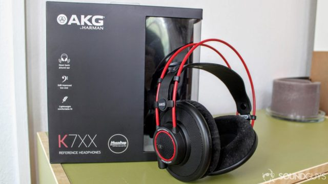 A photo of the AKG K7XX headphones and the packaging on a green desk.