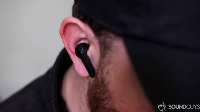 Pictured is Adam wearing the Anker Soundcore Liberty Air.