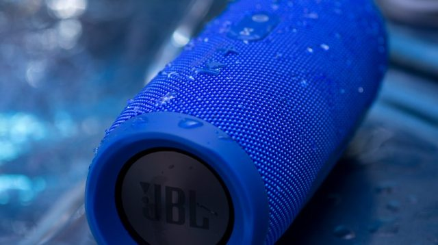 A photo of the JBL Charge 3 used in the hot tub, with water on it - outdoor speakers replacement.
