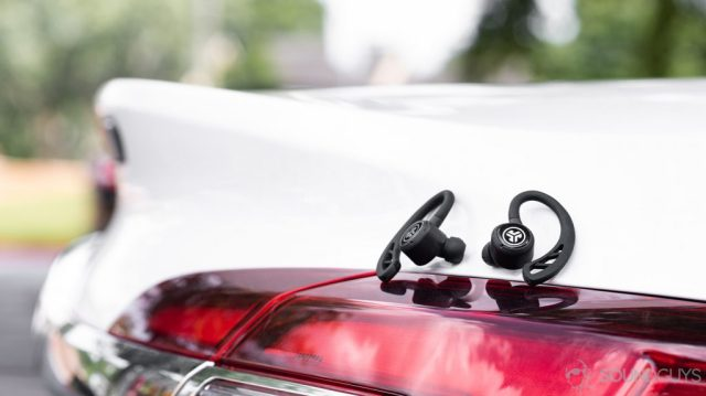 The JLab Epic Air Sport earbuds on a Buick car tail light.