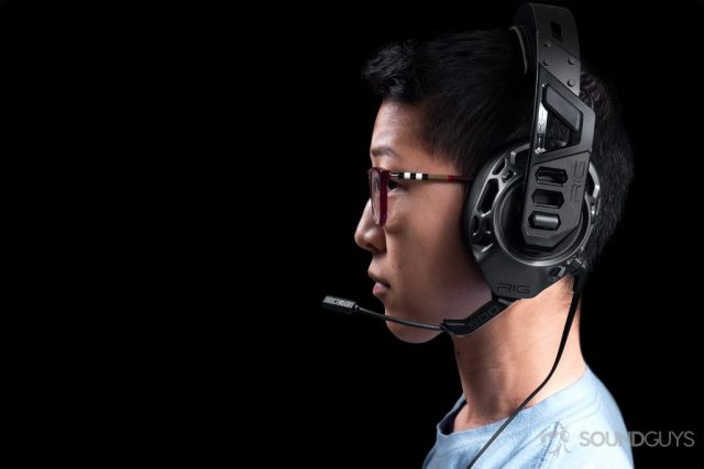 Gaming headset: The profile of a woman wearing the headphones with the boom mic close to the lens.