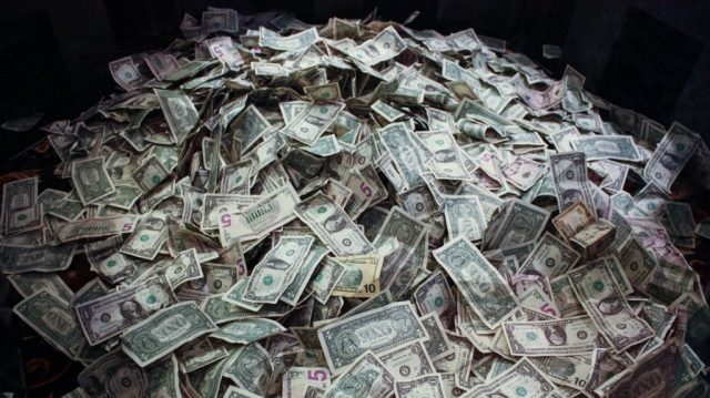 A photo of a pile of US dollar bills.