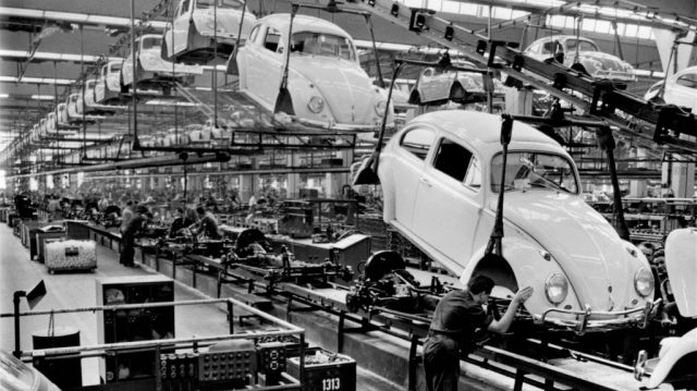 Headphone burn-in isn't real: Black and white image of car manufacturing plant.