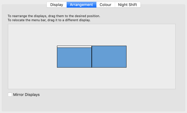MacBook System Preferences with external monitor arrangement options
