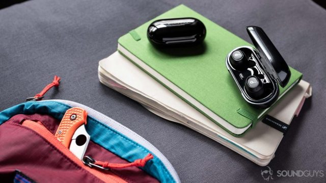 A picture of the Anker SoundCore Liberty Neo true wireless earbuds' charging case open and next to the Samsung Galaxy Buds Plus case for size reference.