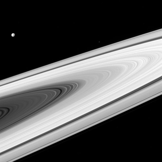 saturn's rings with dione far away