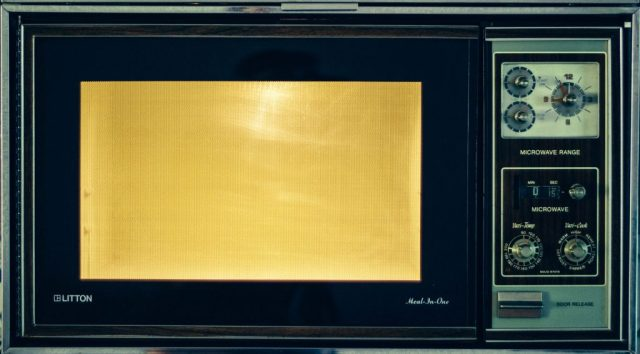 A photo of an old microwave oven in use to help illustrate that, yes, Bluetooth headsets are safe.