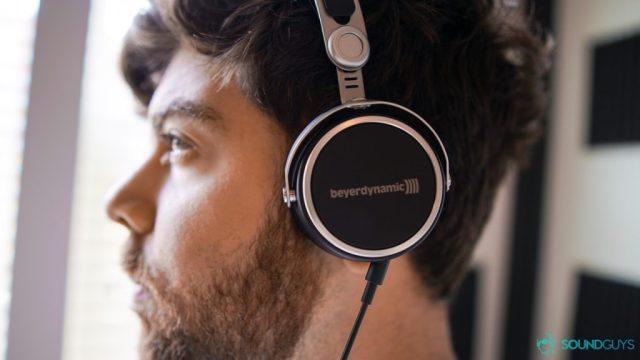 Best on-ear headphones Adam wearing the Aventho Wired headphones.