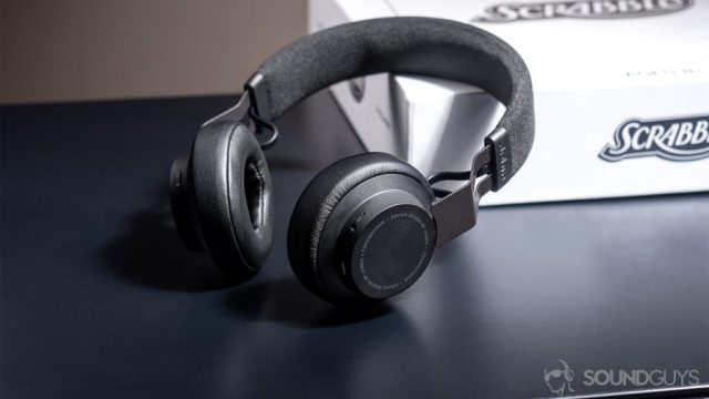 Jabra Move Wireless: One of the bes on-ear headphones propped up against a white Scrabble box.
