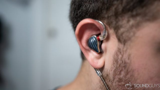 An image of a man wearing the Fiio FH5 in-ear monitors.
